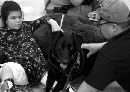 """US Army veteran Ramon Lomeli with his daughter Ellowyn and her service dog Bravo. """"Bravo is Ellowyn's seizure alert. It's a big relief knowing that we can count on him. He's there."""" says Ramon."""