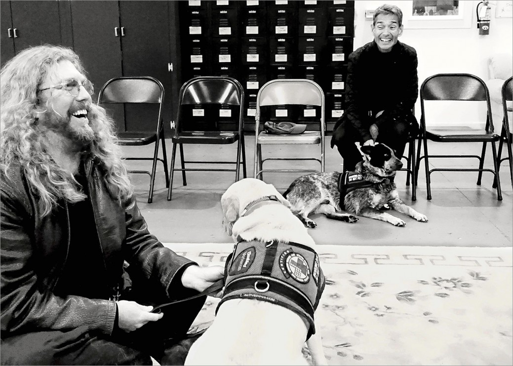 Veterans Jeff Wilson and Steve Loy with their service dogs having a good chuckle during class. The camaraderie between veterans is strong which helps with many issues, including trust.